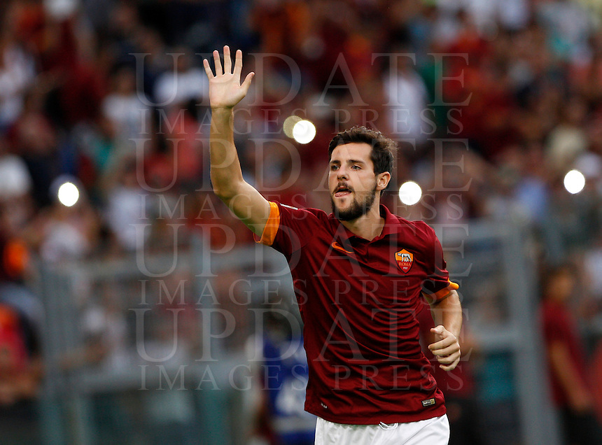 Calcio, amichevole Roma vs Fenerbahce. Roma, stadio Olimpico, 19 agosto 2014.<br /> AS Roma forward Mattia Destro greets fans during the team's presentation, prior to the friendly match between AS Roma and Fenerbache at Rome's Olympic stadium, 19 August 2014.<br /> UPDATE IMAGES PRESS/Riccardo De Luca