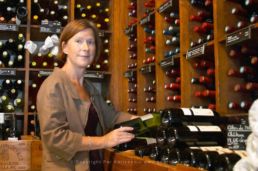 Britt Karlsson, BKWine, in Paris Cave Auge wine shop Paris, France. Wine shop.