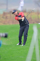 David Howell (ENG) plays his 2nd shot on the 3rd hole during Thursday's Round 1 of the 2014 BMW Masters held at Lake Malaren, Shanghai, China 30th October 2014.<br /> Picture: Eoin Clarke www.golffile.ie