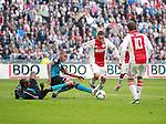 Nederland, Amsterdam, 25 maart 2012.Eredivisie .Seizoen 2011-2012.Ajax-PSV.Atiba Hutchinson (2e van l.) van PSV brengt Ismail Aissati  (3e van l) van Ajax ten val in het strafschopgebied en veroorzaakt een strafschop