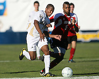 Darlington Naqbe #6 of the University of Akron goes for the ball with Andrew Farrell #5 of the University of Louisville during the 2010 College Cup final at Harder Stadium, on December 12 2010, in Santa Barbara, California.Akron champions, 1-0.