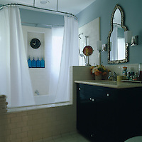 Matching tiles on the floor and the walls of this bath and shower help unify the master bathroom