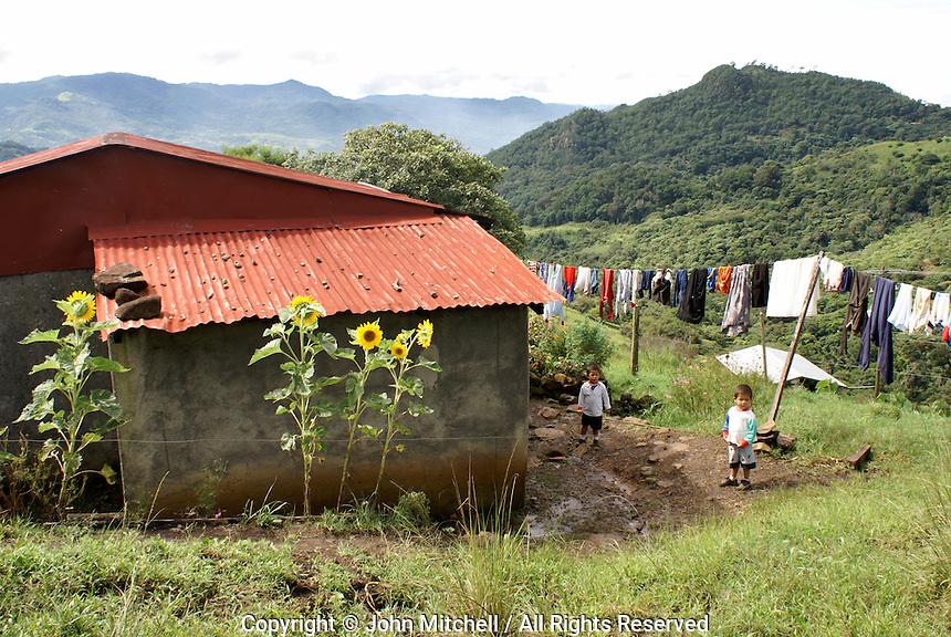 Children standing outside a coffee plantation worker's house at  Finca Selva Negra near Matagalpa, Nicaragua