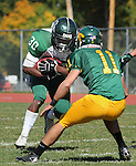 SPEARFISH, S.D. -- Michael Carl #30 of Adams State awaits Black Hills State tackler Austin Haynes #11 during their Rocky Mountain Athletic Conference college football game Saturday afternoon at Lyle Hare Stadium in Spearfish, S.D. (Photo by Richard Carlson/Inertia)