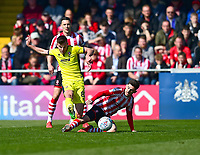 Cheltenham Town's Kevin Dawson is fouled by  Lincoln City's Tom Pett<br /> <br /> Photographer Andrew Vaughan/CameraSport<br /> <br /> The EFL Sky Bet League Two - Lincoln City v Cheltenham Town - Saturday 13th April 2019 - Sincil Bank - Lincoln<br /> <br /> World Copyright © 2019 CameraSport. All rights reserved. 43 Linden Ave. Countesthorpe. Leicester. England. LE8 5PG - Tel: +44 (0) 116 277 4147 - admin@camerasport.com - www.camerasport.com