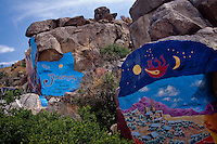 One of the better known attractions in Chloride are murals painted by Roy Purcell.  Ooriginally conceived and painted by in 1996-1997 and then restored May 27-June 2 2006 by Roy Purcell and artists under his direction.  The Murals rise to a height of 30 feet and cover approximately 2000 square feet.  The murals are located up a very rough and steep dirt road, about a mile and a half from Chloride. Chloride is a mining ghost town, but it never completely died, and therefor has the old abandoned buildings and mining equipment,  not having completely died it also has restaurants, gift shops, a silversmith, art gallery's and more.  At one time chloride had over 72 mines operating.
