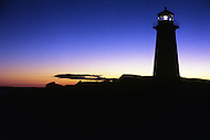 Nova Scotia, Canada, 1967. View of the Peggys Cove lighthouse at sunset.