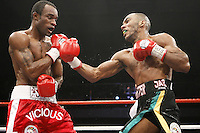 Junior Witter stops Vivian Harris in the 7th round to retain his WBC light welterweight title at the Doncaster Dome, Doncaster.7th September 2007 photo by Chris Royle.
