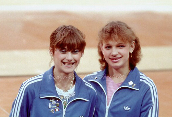 July 15, 1983; Edmonton, Alberta, Canada; (L-R) Nadia Comaneci with Rodica Dunca of Romania pose for photo at 1983 World University Games (Universiade)..Copyright 1983 Tom Theobald<br /> <br /> Photo note: There was some chance Nadia would perform at Edmonton 1983, but her duties were as team coach.  I was with photographer Nancy Raymond and we were just packing our bags.  Then when we noticed this impromptu autograph and photo session happening for fans near us...we went for the photo.  It was worth the whole trip (we drove to Edmonton from California).