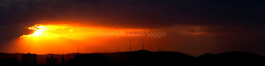 The sun sets over the television towers on Mt Coot-tha in Brisbane.