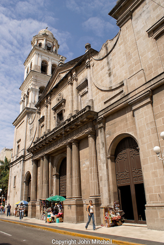 People walking past the 18th-century cathedral on the zocalo or Plaza de Armas in the port of Veracruz, Mexico