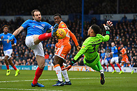Brett Pitman of Portsmouth left is thwarted by Blackpool  keeper Christoffer Mafoumbi  during Portsmouth vs Blackpool, Sky Bet EFL League 1 Football at Fratton Park on 12th January 2019