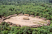 Para State, Brazil. Aerial view of the Xicrin Kayapo village of Catete showing typical circular arrangement of thatched houses with a men's hut in the centre. In the Amazon forest.