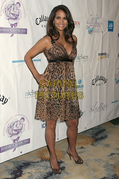 HALLE BERRY.Jenesse Silver Rose Weekend Gala 2008 held at the Beverly Hills Hotel, Beverly Hills, California, USA..April 27th, 2008.full length leopard print dress hands on hips Christian Louboutin shoes peep toe platforms .CAP/ADM/RE.©Russ Elliot/AdMedia/Capital Pictures.