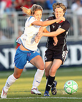 Sonia Bompastor #8 of the Washington Freedom tangles with Sue Weber #20 of the Boston Breakers during a WPS match at the Maryland Soccerplex, in Boyd's, Maryland, on April 18 2009. Breakers won the match 3-1.