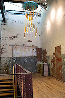 A hallway in the Rivermill Dye House, currently under construction. The chandelier is made from repurposed bobbins from the mill.