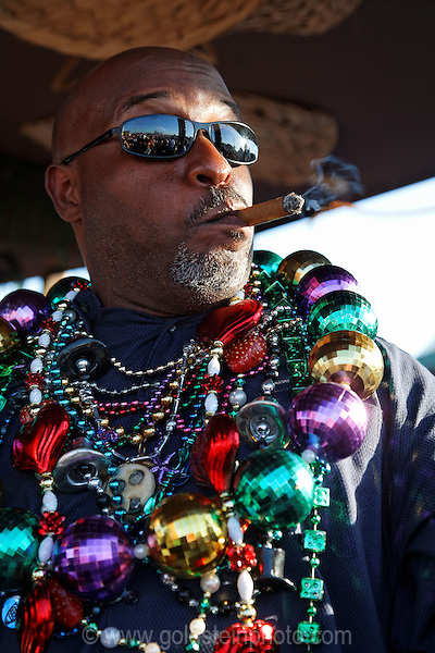 Man with giant beads and cigar Solomons Island Tiki Bar