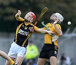 Martin O Leary of Ballyea in action against Garrett Kennedy of Clonlara  during their senior county final replay at Cusack Park. Photograph by John Kelly.