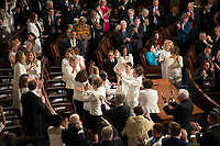 Washington DC, February 5, 2019, USA: Congressional Women Democrats take a moment to cheer earch other during President Donald J Trump  second State of the Union (SOTU) address as President.  House Speaker Nancy Pelosi and Vice President Mike Pence sit behind him in the US Capitol House of Representatives.<br /> CAP/MPI/PYL<br /> &copy;PYL/MPI/Capital Pictures