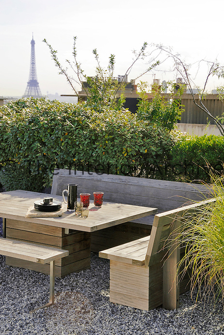 On this roof garden an intimate eating area has been created commanding a wonderfu view of the Eiffel Tower