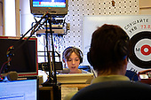 Journalist Aksana Pashina reads the news at the Echo Moscow radio/television station.
