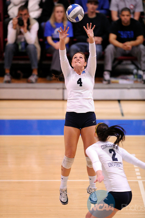 03 DEC 2011:  Amanda Konetchy (4) of Concordia University St. Paul sets the ball against Cal State San Bernardino during the Division II Women's Volleyball Championship held at Coussoulis Arena on the Cal State San Bernardino campus in San Bernardino, Ca. Concordia St. Paul defeated Cal State San Bernardino 3-0 to win the national title. Matt Brown/ NCAA Photos