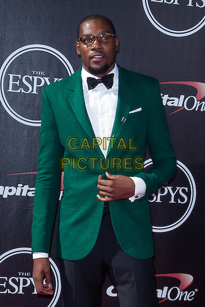 LOS ANGELES, CA - JULY 16: Kevin Durant at the 2014 ESPYs at Nokia Theatre L.A. Live in Los Angeles, California on July 16th, 2014.   <br /> CAP/MPI/mpi99<br /> &copy;mpi99/MediaPunch/Capital Pictures