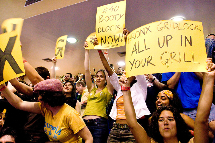 Fans of the Bronx Gridlock show their support at a Gotham Girls Roller Derby bout in New York City on May 6, 2006.