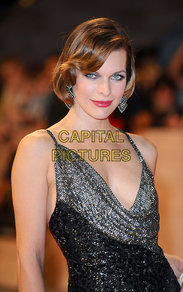 Milla Jovovich (wearing Ferragamo).'The Three Musketeers in 3D' world film premiere, Vue Cinema, Westfield Shopping Centre, London, England..October 4th 2011.half length black dress silver gold cowl sparkly neck pink lipstick red lace embroidered.CAP/BEL.©Tom Belcher/Capital Pictures.