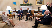 United States President Barack Obama, right center, hosts Their Royal Highnesses Charles, The Prince of Wales, left center, and Camilla, The Duchess of Cornwall, left, for a meeting in the Oval Office of the White House in Washington, D.C. on Thursday, March 19, 2015.   Vice President Joe Biden attends at right.<br /> Credit: Ron Sachs / Pool via CNP