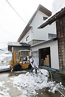 Shoveling snow at Nekka Shochu Distillery, Tadami, Fukushima, Japan, February 20, 2018. The Nekka shochu distillery was founded in July 2016 and at that time was the smallest shochu distillery in Japan. It makes shochu from locally-grown rice, and is helping support a local economy that has languished since the nuclear disaster of 2011.