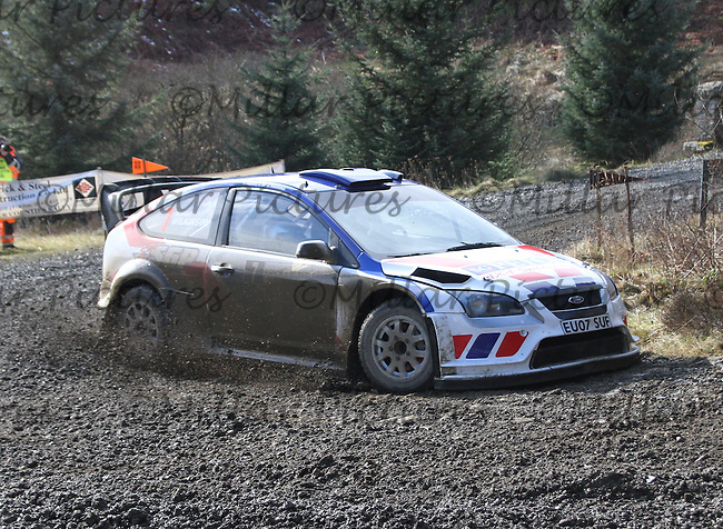 Stephen Petch - Michael Wilkinson in a Ford Focus WRC 08 at Junction 8 on Special Stage 5 Buck Fell on the Brick & Steel Border Counties Rally 2014, Round 2 of the RAC MSA Scottish Rally Championship sponsored by ARR Craib Transport Limited and other championships  and organised by Whickham & District and Hawick & Border Car Clubs and based in Jedburgh and held in Kielder Forest on 22.3.14.
