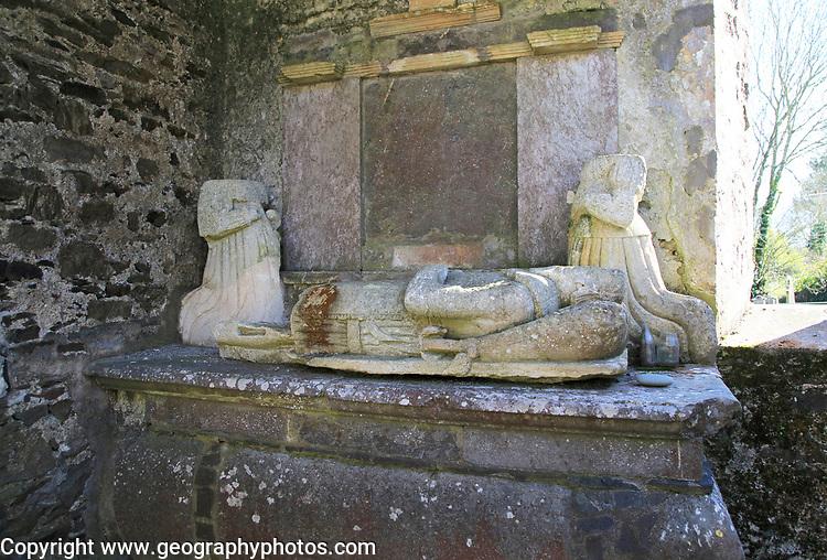 Weathered damaged memorials inside seventeenth century Kilcredan church ruins and graveyard, County Cork, Ireland