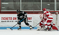 BOSTON, MA - JANUARY 11: Annelise Rice #23 of Providence College moves behind the net as Corinne Schroeder #30 of Boston University and Natasza Tarnowski #13 of Boston University watch during a game between Providence College and Boston University at Walter Brown Arena on January 11, 2020 in Boston, Massachusetts.