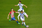 Atletico de Madrid's Filipe Luis (l) and Real Sociedad's Alvaro Odriozola (t) and Carlos Vela during La Liga match. April 4,2017. (ALTERPHOTOS/Acero)