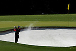 AUGUSTA, GA- APRIL 13:  Tiger Woods hits his 2nd shot out of the green bunker on the 4th hole during a the final round of the 2008 Masters on April 13, 2008 at Augusta National Golf Club in Augusta, Georgia. (Photo by Donald Miralle)