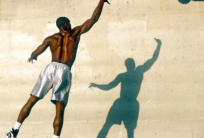 Basketball player shooting the ball.