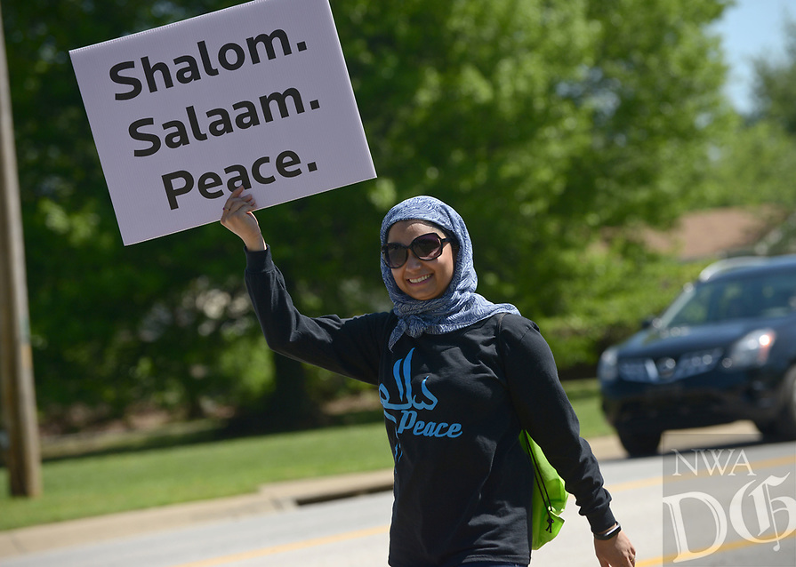 NWA Democrat-Gazette/BEN GOFF @NWABENGOFF<br /> Fatima Shah of Bella Vista, a member of the Bentonville Islamic Center, walks Sunday, April 23, 2017, as participants in the Abraham Peace Walk from Waterway Christian Church to the Bentonville Islamic Center make their way allong Southwest 2nd Street. Members of Waterway Christian Church, First Christian Church of Bentonville, Congregation Etz Chaim and the Bentonville Islamic Center walked together in a show of peace between Christianity, Judaism and Islam, which all trace their roots to the biblical patriarch Abraham.