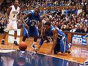 Duke guard Nolan Smith (4) looks on with intent as St. Louis forward Dwayne Evans (21) and guard Mike McCall (11) scramble for a loose ball at the Duke vs. St. Louis basketball game Saturday, December 11, 2010. (Photo by Al Drago)