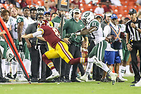 Landover, MD - August 16, 2018: New York Jets defensive back Terrence Brooks (23) pushes Washington Redskins quarterback Kevin Hogan (8) out of bounds during the preseason game between New York Jets and Washington Redskins at FedEx Field in Landover, MD.   (Photo by Elliott Brown/Media Images International)