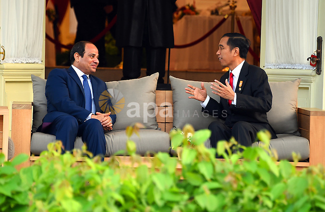 Egypt's President Abdel Fattah al-Sisi walks meets with Indonesia's President Joko Widodo at the presidential palace in Jakarta on September 4, 2015. Al-Sisi, who arrived from Beijing, is on the final stop of his near week-long Asian trip. Photo by Egyptian President Office