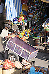 A man pushes a cart and makes his way through the market in Marrakesh, Morocco.