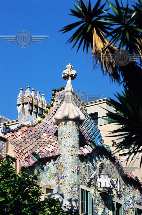 Casa Batllo or Batilo. This is a building designed by Antoni Gaudi and Josep Maria Jujol and built in years 1905?1907; located at Passeig de Gracia, part of the Illa de la Discordia in the Eixample district. Architecture in Modernisme or Art Nouveau style. Much of the facade is decorated with a mosaic made of broken ceramic tiles...