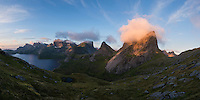 Kråkhammartind mountain peak illuminated at sunrise, Moskenesøy, Lofoten Islands, Norway