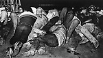 Native Americans lying on the floor in a heap in the drunk tank cell of Gallop Police Dept. They are collected by a bus throughout the evening from street corners in the bar section of the city, in November, 1983.  Photo by Jim Peppler. Copyright/Jim Peppler/.