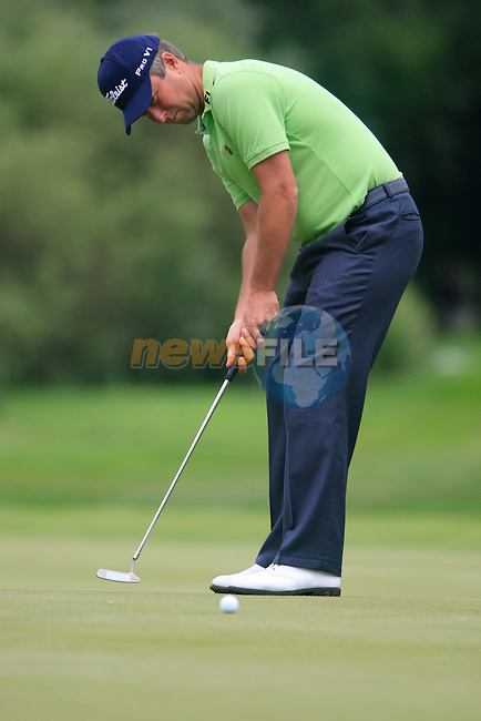 Mark Foster (ENG) takes his putt on the par3 17th hole during of Day 3 of the BMW International Open at Golf Club Munchen Eichenried, Germany, 25th June 2011 (Photo Eoin Clarke/www.golffile.ie)
