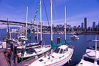 Vancouver, BC, British Columbia, Canada - City Skyline at False Creek, Sailboats docked at Granville Island, Aquabus Ferry Public Transportation