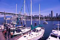 Vancouver, BC, British Columbia, Canada - City Skyline at False Creek, Sailboats docked at Granville Island, Aquabus Ferry Public Transportation
