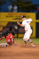 Springfield Cardinals second baseman Jacob Wilson (7) attempts to turn a double play as Ryan Rua (9) slides in during a game against the Frisco Rough Riders on June 1, 2014 at Hammons Field in Springfield, Missouri.  Springfield defeated Frisco 3-2.  (Mike Janes/Four Seam Images)