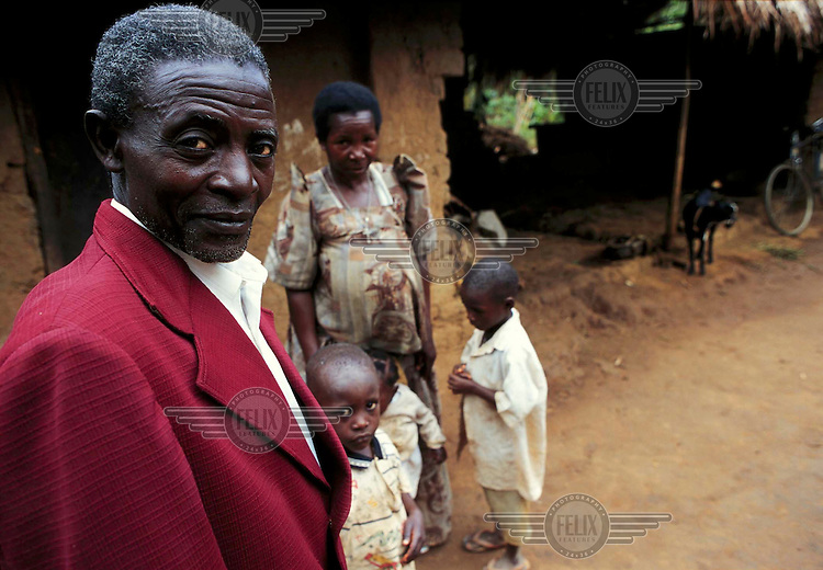 Michael Kakooza Ssalongo, his wife Demetria Nakiwala and their family outside their home. Kakooza is HIV-positive and was part of the well known Rakai investigation into AIDS.